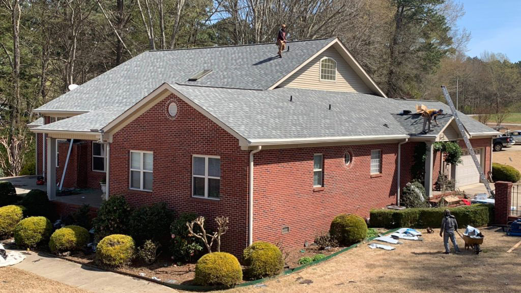 Shingle Roof Contractor working on roof replacement in Huntsville, AL